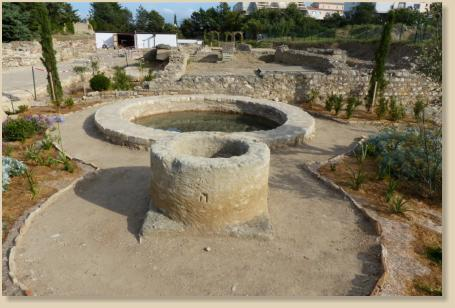 The circular basin and the well